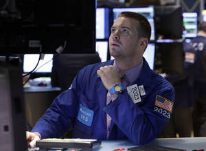 Photo - FILE - In this  Monday, Sept. 16, 2013, file photo, specialist Frank Masiello works on the floor of the New York Stock Exchange. (AP Photo/Richard Drew, File)