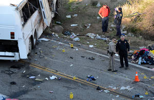 photo - Authorities work Monday Feb. 4, 2013, at the scene of Sunday&#039;s fatal tour bus crash on Highway 38 north of Yucaipa, Calif., that left at least eight people dead and dozens injured. The cause of the Sunday crash east of Los Angeles remained under investigation. (AP Photo/The Sun, Rick Sforza)