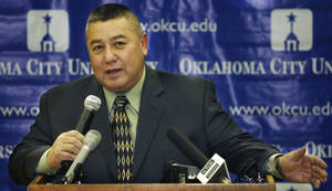 photo - Archie Randall, OCU head wrestling coach, thinks pulling the sport out of the Olympics is &#039;a slap in the face.&#039; Photo by The Oklahoman Archives