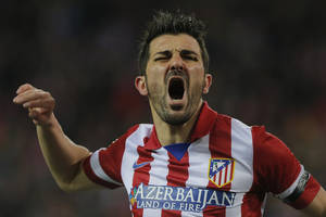 Photo - Atletico's David Villa complains to the referee during a Spanish La Liga soccer match between Atletico de Madrid and  Real Sociedad at the Vicente Calderon stadium in Madrid, Spain, Sunday, Feb. 2, 2014. (AP Photo / Andres Kudacki)