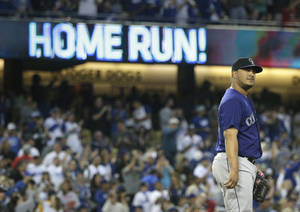 Photo - Colorado Rockies starting pitcher Jhoulys Chacin stands on the mound after giving up a two-run home run to Los Angeles Dodgers' Hanley Ramirez during the third inning of a baseball game on Tuesday, June 17, 2014, in Los Angeles. (AP Photo/Jae C. Hong)