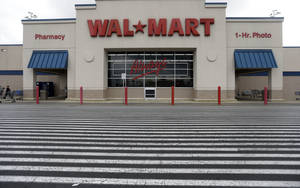 Photo - A Walmart store is shown in Bristol, Pa. Walmart's third-quarter profits increased, but the world's largest retailer cut its annual outlook. AP Photo <strong>Matt Rourke</strong>