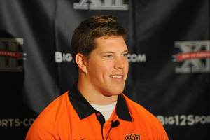 photo - OSU: Oklahoma State University's Cooper Bassett responds to questions from reporters during the Big 12 Media Day at the Westin Galleria in Dallas, Texas, Tuesday, July 24, 2012. (Michael Prengler/Fort Worth Star-Telegram/MCT) ORG XMIT: 1126244