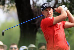 Photo - Henrik Stenson of Sweden plays a shot during the second round of the Dubai Desert Classic golf tournament in Dubai, United Arab Emirates, Friday Jan. 31, 2014. (AP Photo)