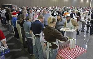 photo - Volunteers serve at the Red Andrews Christmas Dinner on Sunday, Dec. 25, 2011, in Oklahoma City, Okla. Photo by Steve Sisney, The Oklahoman