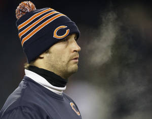 Photo - Injured Chicago Bears quarterback Jay Cutler walks around the field during team warmups before an NFL football game between the Bears and the Dallas Cowboys, Monday, Dec. 9, 2013, in Chicago. (AP Photo/Nam Y. Huh)