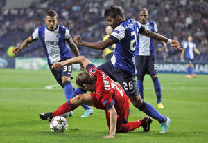 Photo -   Paris Saint Germain's Clement Chantome vies for the ball with Porto's Alex Sandro, top, from Brazil, during their Champions League group A soccer match at Porto's Dragao stadium in Porto, Wednesday, Oct. 3, 2012. (AP Photo/Francisco Seco)