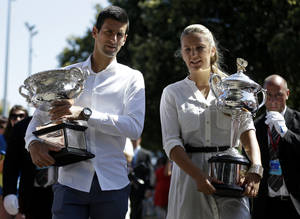 Photo - Defending champions Victoria Azarenka of Belarus and Serbia's Novak Djokovic pose with their trophies prior to the official draw of the Australian Open tennis championship in Melbourne Australia, Friday, Jan. 10, 2014. (AP Photo/Aijaz Rahi)