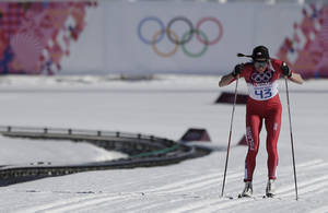 Photo - Poland's Justyna Kowalczyk skis as she is to win the gold during the women's 10K classical-style cross-country race at the 2014 Winter Olympics, Thursday, Feb. 13, 2014, in Krasnaya Polyana, Russia. (AP Photo/Matthias Schrader)