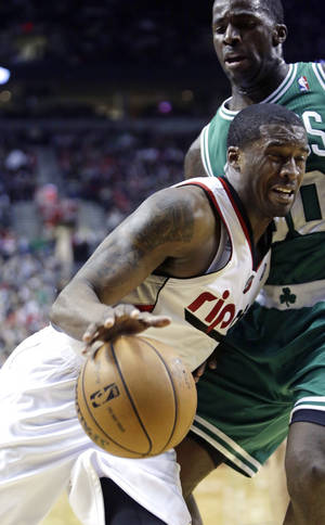 photo - Portland Trail Blazers guard Wesley Matthews, left, drives the baseline against Boston Celtics forward Brandon Bass during the second half of an NBA basketball game in Portland, Ore., Sunday, Feb. 24, 2013.  Matthews led the Trail Blazers in scoring with 24 points as they beat the Celtics 92-86.(AP Photo/Don Ryan)