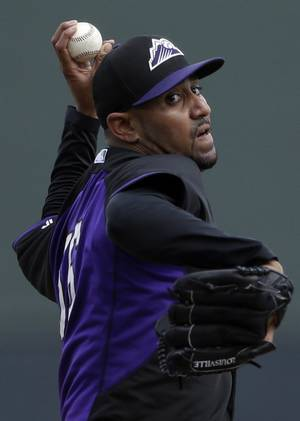 Photo - Colorado Rockies starting pitcher Franklin Morales throws against the Arizona Diamondbacks during the first inning in a spring training baseball game on Friday, Feb. 28, 2014, in Scottsdale, Ariz. (AP Photo/Gregory Bull)