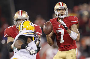 photo - San Francisco quarterback Colin Kaepernick, right, is part of a dynamic group of young signal callers that include rookies Andrew Luck, Robert Griffin III and Russell Wilson. AP PHOTO