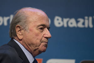 Photo - FIFA President Sepp Blatter arrives for a press conference where he talked about the organization and infrastructure of the upcoming World Cup, in Sao Paulo, Brazil, Thursday, June 5, 2014. The World Cup soccer tournament starts on 12 June. (AP Photo/Andre Penner)