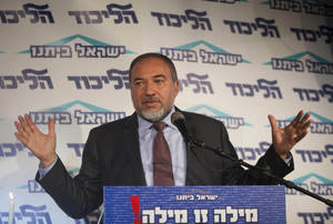 photo - Israel's Foreign Minister Avigdor Lieberman speaks to the media during an event in Tel Aviv, Israel, Thursday, Dec. 13, 2012.  Israel's powerful foreign minister resisted calls to resign after he was charged Thursday with breach of trust for actions that allegedly compromised a criminal investigation into his business dealings, throwing the country's election campaign into disarray just weeks before the vote. (AP Photo/Dan Balilty)