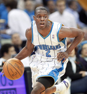 Photo - Point guards like New Orleans' Darren Collison, who the Thunder face today, have benefitted from the league's hand-check rule change. AP photo