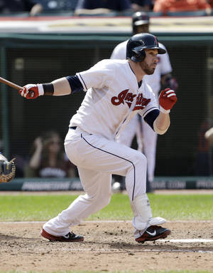 Photo - Cleveland Indians' Jason Kipnis hits a single off Kansas City Royals starting pitcher James Shields in the ninth inning of a baseball game, Wednesday, Sept. 11, 2013, in Cleveland. The Royals won 6-2. (AP Photo/Tony Dejak)