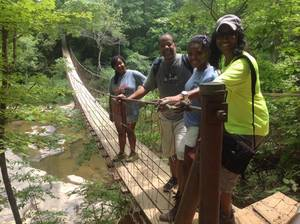 Photo - Road Trip crew on the suspension bridge headed toward the Nature Center at Fall Creek Falls. Photo by Carla Meadows