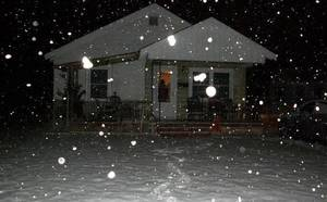 Photo - Snow falls on a house in Oklahoma. Contributed by Ashlea Robinson.