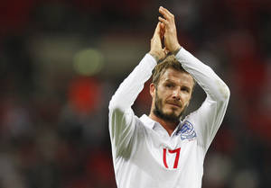 "Photo -   FILE This Wednesday, Oct. 14, 2009 file photo shows England's David Beckham applauding the crowd after their World Cup group 6 qualifying soccer match against Belarus at Wembley Stadium, London. Former England captain David Beckham has failed to make the British football team for the London Olympics. The Los Angeles Galaxy midfielder made Britain coach Stuart Pearce's shortlist of 35 but wasn't selected for the final 18-man squad as one of three players over the age of 23 allowed to compete in the games. ""Everyone knows how much playing for my country has always meant to me, so I would have been honored to have been part of this unique Team GB squad,"" the 37-year-old Beckham said Thursday June 28, 2012 in a statement to The Associated Press.(AP Photo/Kirsty Wigglesworth)"