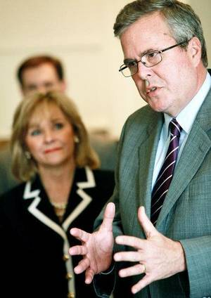 Photo - Former Florida Governor Jeb Bush and Oklahoma Governor Mary Fallin (background) speak during a press conference on education reform in The Blue Room at the Oklahoma State Capitol in Oklahoma City on Wednesday, March 30, 2011. Photo by John Clanton, The Oklahoman ORG XMIT: KOD