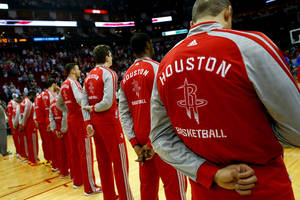 Photo - HOUSTON, TX - MARCH 29:  Members of the  Houston Rockets stand during the National Anthem before the game against the Los Angeles Clippers at the Toyota Center on March 29, 2014 in Houston, Texas. NOTE TO USER: User expressly acknowledges and agrees that, by downloading and or using this photograph, User is consenting to the terms and conditions of the Getty Images License Agreement. (Photo by Scott Halleran/Getty Images)