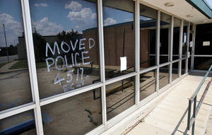 photo - Front windows of the old police station on Epperly Drive. The new police station in Del City was officially dedicated Thursday afternoon. <strong>Jim Beckel - THE OKLAHOMAN</strong>