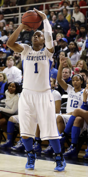 Photo - Kentucky's A'dia Mathies shoots a 3-point basket in the second half of a second-round game against Dayton in the NCAA women's college basketball tournament Tuesday, March 26, 2013, in New York. Kentucky won 84-70. (AP Photo/Frank Franklin)
