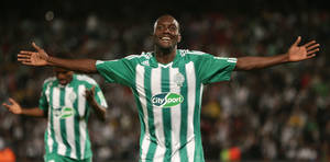 Photo - Raja Casablanca's Vivien Mabide celebrates after scoring his side's third goal during the semi final soccer match between Raja Casablanca and Atletico Mineiro at the Club World Cup soccer tournament in Marrakech, Morocco, Wednesday, Dec. 18, 2013. (AP Photo/Matthias Schrader)