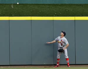 Photo - St. Louis Cardinals' Peter Bourjos watches a three-run home run hit by Cincinnati Reds' Todd Frazier in the third inning of a baseball game, Friday, May 23, 2014, in Cincinnati. (AP Photo/Al Behrman)