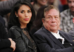 Photo - FILE - In this Dec. 19, 2010, file photo, Los Angeles Clippers owner Donald Sterling, right, and V. Stiviano, left, watch the Clippers play the Los Angeles Lakers during an NBA preseason basketball game in Los Angeles. NBA Commissioner Adam Silver is intent on moving quickly in dealing with the racially charged scandal surrounding Clippers owner Sterling. The NBA league will discuss its investigation Tuesday, April 29, 2014, before the Clippers play Golden State in Game 5 of their playoff series. (AP Photo/Danny Moloshok, File)