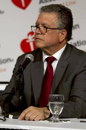Photo -   Dr. Gervasio Lamas of Mount Sinai Medical Center in Miami, the leader of a study testing a controversial and experimental treatment for heart disease, speaks at an American Heart Association conference in Los Angeles, Sunday, Nov. 4, 2012. (AP Photo/American Heart Association, Matthew G. Fisher)