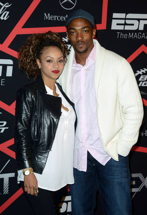 "Photo - Actor Anthony Mackie, right, and Sheletta Chapital arrive at ESPN The Magazine's ""Next"" Event on Friday, Feb. 1, 2013 in New Orleans. (Photo by Jordan Strauss/Invision/AP)"