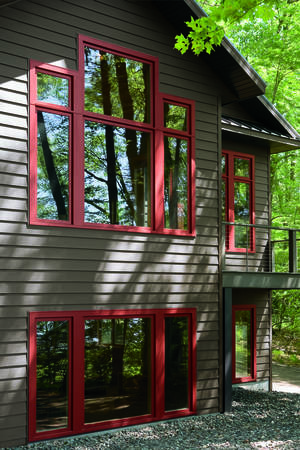 Photo - Many people are afraid to use more than one color on the exterior of their home. That's why so many houses appear dull and lifeless. Consider using two colors of siding and a third color for your trim boards to add personality and vitality to the exterior. Photo courtesy of Apex Ultrex Siding.