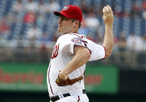 Photo - Washington Nationals starting pitcher Jordan Zimmermann throws during the first inning of a baseball game against the Atlanta Braves at Nationals Park Thursday, June 19, 2014, in Washington. (AP Photo/Alex Brandon)