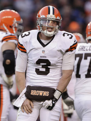Photo - Cleveland Browns quarterback Brandon Weeden (3) reacts after being injured on a sack by the Denver Broncos in the third quarter of an NFL football game, Sunday, Dec. 23, 2012, in Denver. (AP Photo/Joe Mahoney)