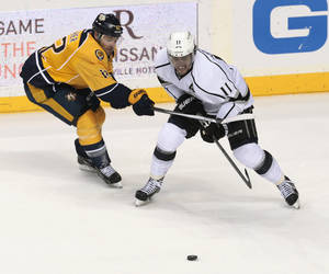 Photo - Nashville Predators forward Mike Fisher (12) tries to keep Los Angeles Kings center Anze Kopitar (11), of Slovenia, off the puck during the second period of an NHL hockey game Saturday, Dec. 28, 2013, in Nashville, Tenn. (AP Photo/Mark Humphrey)