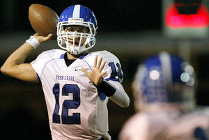 photo - Deer Creek's quarterback Joel Blumenthal throws a pass downfield against Southeast during their high school football game at C.B. Speegle Stadium in south Oklahoma City on Thursday, September 29, 2011. Photo by John Clanton, The Oklahoman