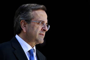 Photo - Greek Prime Minister Antonis Samaras waits the arrival of  Lebanese President Michel Suleiman  in Athens, Thursday, Dec. 6, 2012. Greece's is finalizing a major tax reform bill, demanded by international rescue creditors as one of several conditions for continued payments. Greece's conservative-led government has promised to try and stem the country's punishing recession, but last month introduced another round of austerity measures. New unemployment figures, released Thursday, showed the country's jobless rate rising to 26 percent in September.  (AP Photo/Petros Giannakouris)