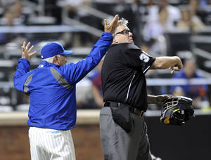 Photo - New York Mets manager Terry Collins, left, reacts as home plate umpire Gary Cederstrom, right, ejects him from during the fifth inning of a baseball game against the Milwaukee Brewers, Wednesday, June 11, 2014, at Citi Field in New York. (AP Photo/Bill Kostroun)