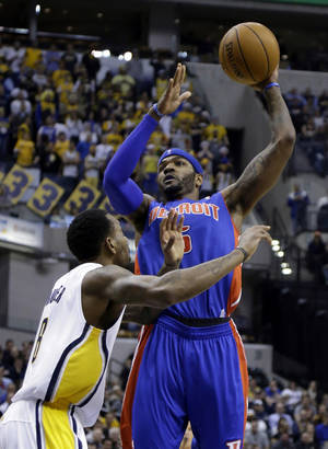 Photo - Detroit Pistons forward Josh Smith, right, shoots over Indiana Pacers guard Rasual Butler in the first half of an NBA basketball game in Indianapolis, Monday, Dec. 16, 2013.  (AP Photo/Michael Conroy)