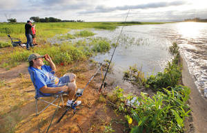 Photo -  Vince Priest, Oklahoma City, fishes just after sunrise on the west side of Lake Hefner where the canal enters in Oklahoma City on Friday. Photo by Paul B. Southerland, The Oklahoman  <strong>PAUL B. SOUTHERLAND -  PAUL B. SOUTHERLAND </strong>