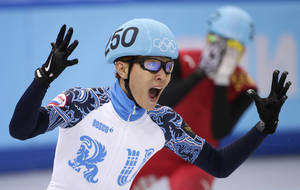 Photo - Victor An of Russia reacts as he crosses the finish line first in the men's 500m short track speedskating final at the Iceberg Skating Palace during the 2014 Winter Olympics, Friday, Feb. 21, 2014, in Sochi, Russia. (AP Photo/Bernat Armangue)
