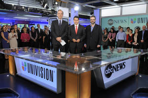 Photo -   In this image released by ABC, ABC News president Ben Sherwood , left, Univision Networks president Cesar Conde, center, and Univision News president Isaac Lee pose as they announce the joint venture between ABC News and Univision News, Monday, May 7, 2012 in New York. (AP Photo/ABC, Lorenzo Bevilaqua)