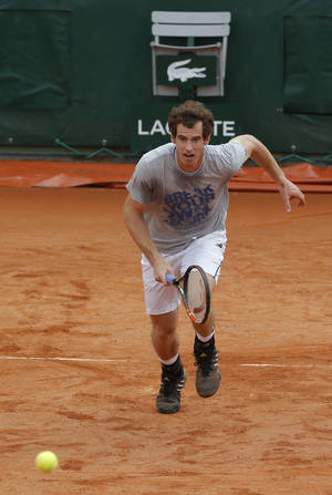 Photo - Britain's Andy Murray runs for the ball during a training session for the French Open tennis tournament, at the Roland Garros stadium in Paris, Friday, May 23, 2014. The French Open tennis tournament starts Sunday. (AP Photo/Michel Euler)
