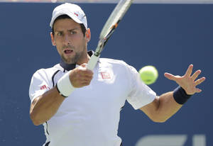 photo -   Serbia's Novak Djokovic returns a shot to Brazil's Rogerio Dutra Silva in the third round of play at the 2012 US Open tennis tournament, Friday, Aug. 31, 2012, in New York. (AP Photo/Mike Groll)