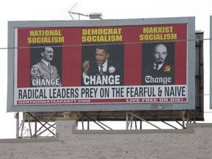 Photo - A billboard ordered and paid for by the North Iowa Tea Party shows President Barack Obama, Adolf Hitler, left and Vladimir Lenin, on South Federal Avenue in Mason City, Iowa, July 12, 2010. (AP Photo/Globe Gazette, Deb Nicklay)