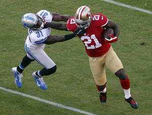 Photo -   San Francisco 49ers running back Frank Gore, right, carries the ball past Detroit Lions defensive back Drayton Florence, left, during the second quarter of an NFL football game in San Francisco, Sunday, Sept. 16, 2012. (AP Photo/Tony Avelar)