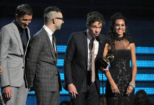 "Photo - members of fun., from left, Nate Ruess, Andrew Dost and Jack Antonoff accept the award for song of the year for ""We Are Young"" at the 55th annual Grammy Awards on Sunday, Feb. 10, 2013, in Los Angeles. (Photo by John Shearer/Invision/AP)"