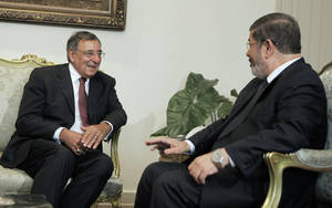 Photo -   Egypt's newly elected President Mohammed Morsi, right, meets with US defense Secretary Leon Panetta in Cairo, Egypt, Tuesday, July 31, 2012. Panetta is seeking assurances from Egypt's new Islamist government that the country will remain a military partner at a time of political tumult in the Middle East and growing worry about Iran's nuclear ambitions. (AP Photo/Amr Nabil)