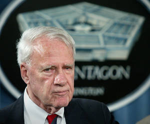 Photo - FILE - This Aug. 24, 2004 file photo shows former Defense Secretary James Schlesinger, chairman of the Detention Operations Review Panel speaking at the Pentagon. A Washington think tank confirms Schlesinger has died. (AP Photo/Lawrence Jackson, File)